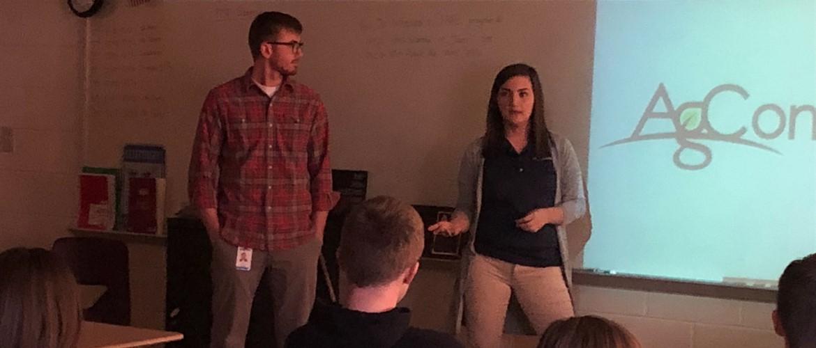 Former students Tyler Dodson and Starla Hicks speak to the agriculture classes about their employment with Ag Connections in Murray, Kentucky.