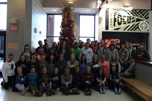 Seniors decorating the high school commons area for Christmas!