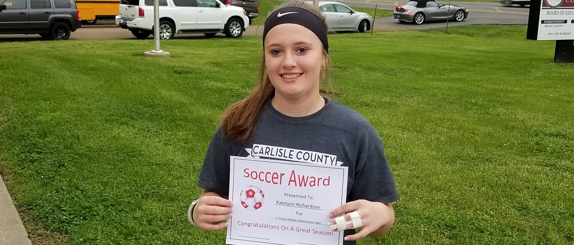Katie Richardson accepting certificate for All-District Soccer Team